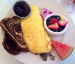 breakfast house omelette with articoke mushroom and swiss